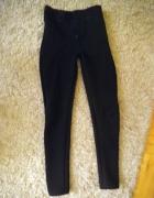 czarne materiałowe wybijane spodnie hm s m