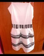 Biała sukienka rozkloszowana...