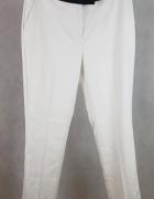 Eleganckie białe spodnie z czarnymi wstawkami materiałowe Next ...
