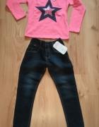 Różowa bluzka dziewczęca i jeansy 110...