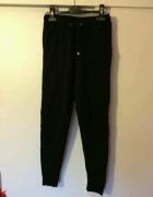 czarny elegancki dres spodnie dresowe zwężane czarne rurki...