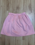 Rozkloszowana spodnica pudrowy roz...