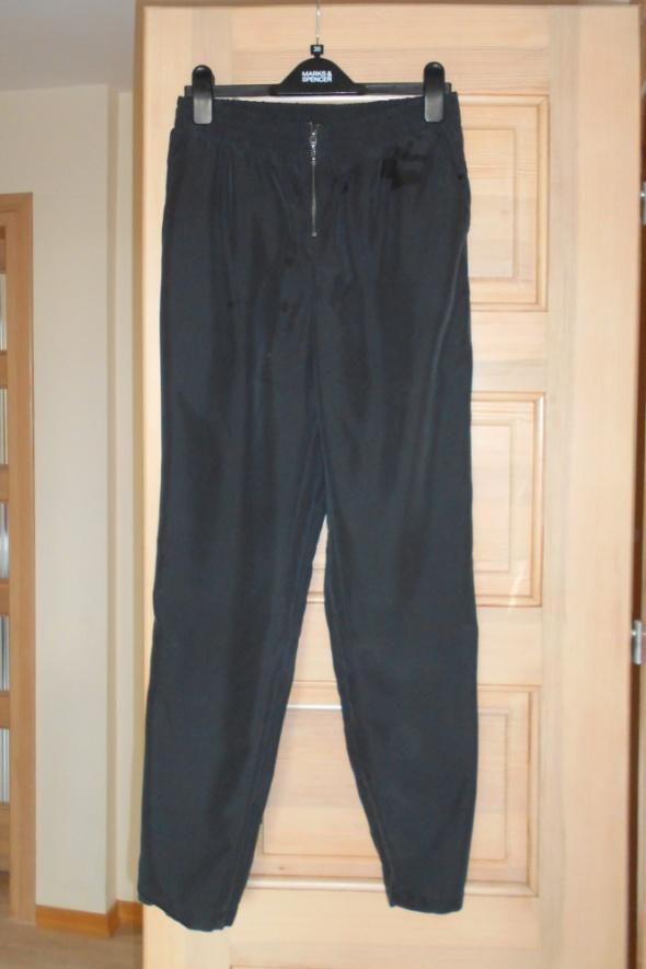 HM luźne spodnie zamek z przodu acne cos minimal