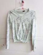 miętowy sweter w jaskółki H&M...