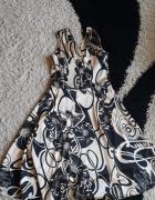 Sukienka w kolorze złota 42 XL