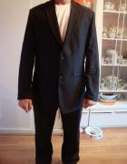 Nowy garnitur czarny w prazki 182cm...