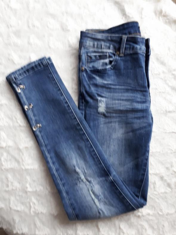 spodnie skinny rurki dziury wytracia...