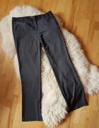 Materiałowe eleganckie spodnie Orsay 40 42...