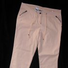 Brzoskwiniowe spodnie ozdobne zamki 40 L