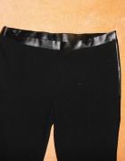 Materiałowe spodnie ala legginsy L skórzane wstawki...