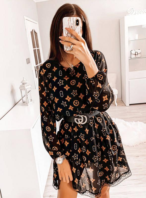 Nowa sukienka z wzorem i falbanką L wiosna