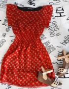 Czerwona sukienka w słoneczniki...
