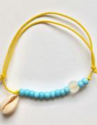 Bransoletka żółta gumka niebieskie koraliki muszelka