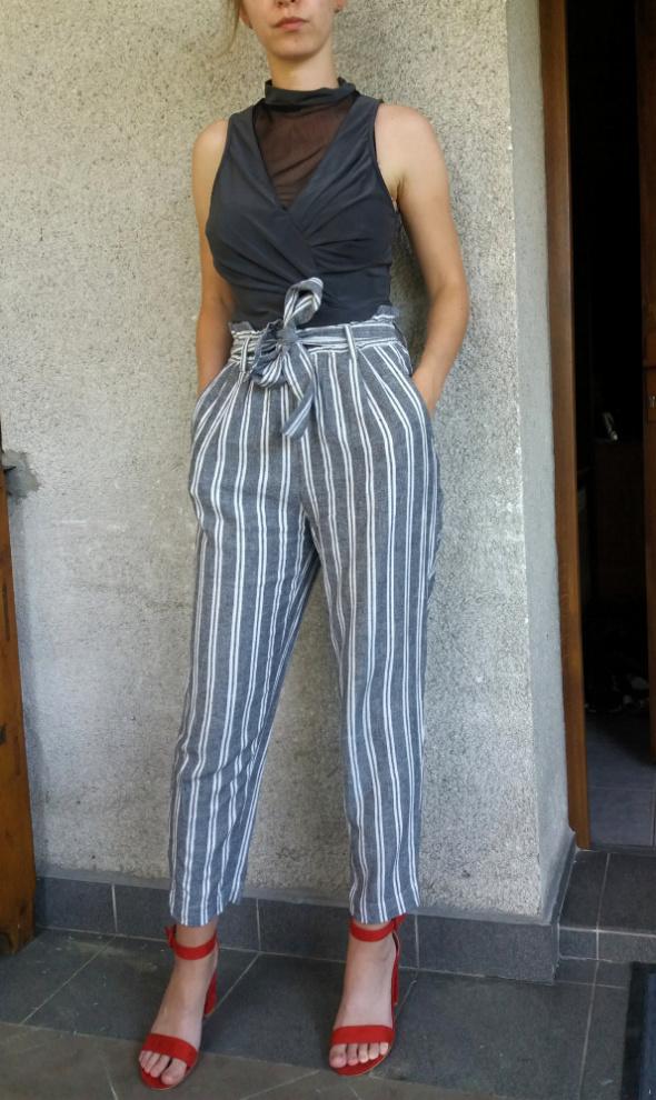 Spodnie Świetne szare spodnie w paski z wysokim stanem wiązane H&M 36
