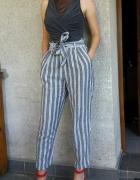 Świetne szare spodnie w paski z wysokim stanem wiązane H&M 36