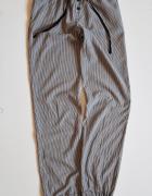 H&M Cieniutkie letnie spodnie damskie w paski Ska...