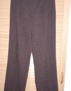 Brązowe materiałowe spodnie...