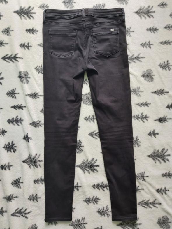 Czarne jeansy 40