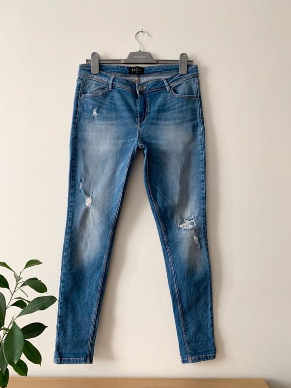 Mohito jeansy spodnie z dziurami skinny 40