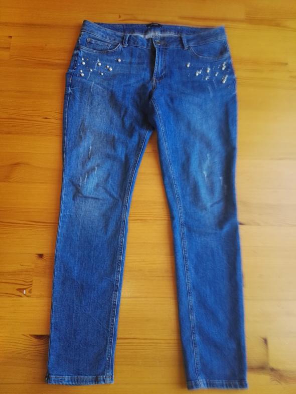 Spodnie jeansowe rozmiar 44...