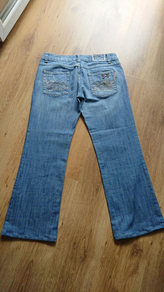 Spodnie jeansowe damskie niebieskie w rozmiarze 31...