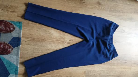 Spodnie eleganckie damskie w rozmiarze 42 L