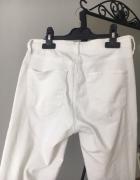 Białe spodnie rurki topshop XS z dziurami...