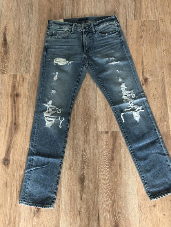 Męskie jeansy z przetarciami