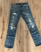 Męskie jeansy z przetarciami...