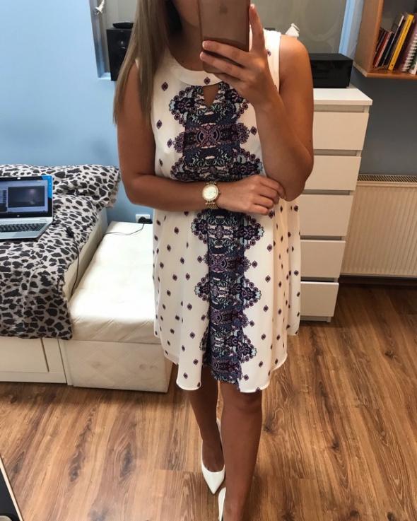 Sukienka trapezowa L