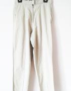 Jasnobeżowe długie spodnie cygaretki chinosy z wysokim stanem...