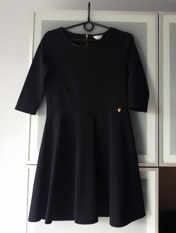 Elegancka czarna sukienka wizytowa rozmiar S