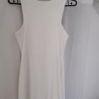 Biała sukienka efektownym zamkiem