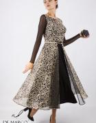 Rozkloszowana sukienka w kolorze czarnym z złotą koronką De Mar...