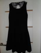 Czarna sukienka imprezowa...