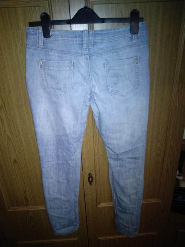 Klasyczne jasne jeansy 38 M...
