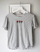Bawełniany T shirt w paski z naszywkami...