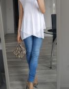 Biała elegancka bluzka bez rękawów