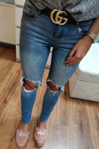 Spodnie jeansy dziury SinSay XS...