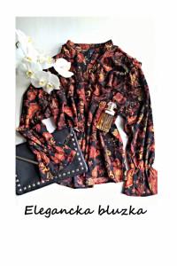 Elegancka bluzka we wzory L XL...