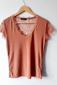 Elegancka pomarańczowa bluzka z koronką...