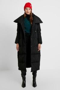 Stylowy przedłużany zimowy płaszcz puchowy Kiomi ociepany