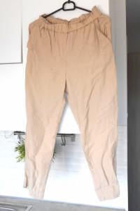 HM kremowe lniane spodnie nude len chinosy