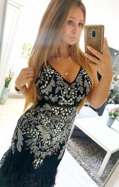 Suknie i sukienki Sukienka czarna Asos piórka cekiny 38 M