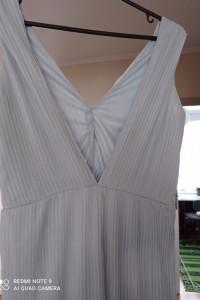Plisowana błękitna długa sukienka...
