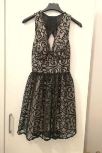 Nowa sukienka koronkowa wycięte plecy czarna dekolt XS...