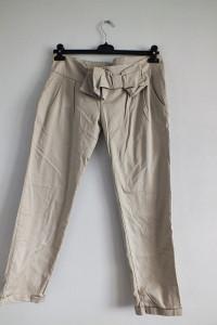 Beżowe eleganckie spodnie z kokardą r 44...