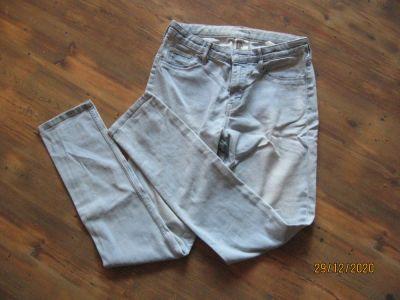 Spodnie i spodenki Dżinsy rurki HM rozmiar 152