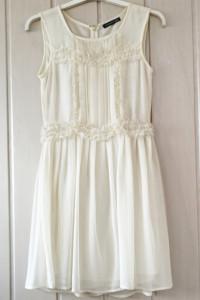 Kremowa sukienka...