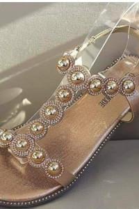 Złote zdobione sandałki...